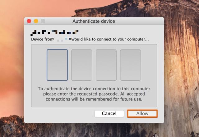 Macの画面に表示された入力画面に4桁の数字を入力する